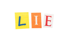 Lie cut out letters inscription Royalty Free Stock Image