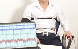 Lie Detector. A man passes a lie detector test