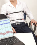 Lie Detector. A man passes a lie detector test Royalty Free Stock Photography