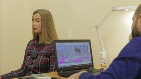 Lie-detector test, a woman answers the questions of the expert stock footage