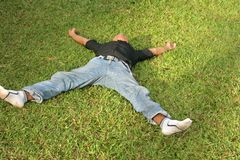 Lie down on grass Royalty Free Stock Image