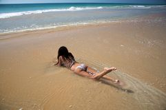 Lie down on ocean Royalty Free Stock Photography