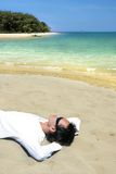 Lie down on tropical beach Royalty Free Stock Photography