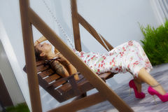 Lie on the swing Stock Photo