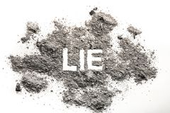 Lie word written in ash, dust, sand. As a bad text, habbit or wrong deceit behavior concept stock photos