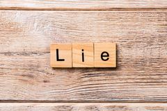 LIE word written on wood block. LIE text on wooden table for your desing, concept.  royalty free stock image