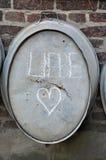 Liebe = amour, et coeur Photos libres de droits