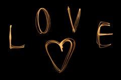 Liebe auf Schwarzem Stockfoto