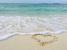 Liebe auf Strand Stockfoto