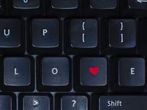 Liebe auf Tastatur Stockfotografie