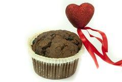 Liebe für Schokoladen-Muffin Stockfoto