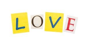 Liebe herausgeschnitten von den Buchstaben Lizenzfreies Stockfoto
