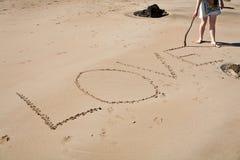 Liebe im Sand Stockfotos