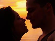 Liebe im Sonnenuntergang Stockbild