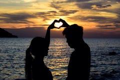 Liebe ist der bauetiful colorfullsky Sonnenuntergang Stockbilder