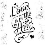 Liebe ist in der Luft Kalligraphische Beschriftung, Schmutzart stockfotos