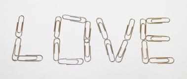 Liebe mit Papierklammern Stockfotos