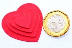 Liebe oder Geld Stockbild