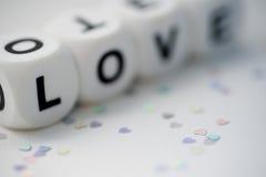 Liebe, Würfelbuchstaben Stockbild