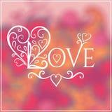 Lieben Sie Sie Text auf Blurred Hintergrund mit Blumen Lizenzfreie Stockbilder