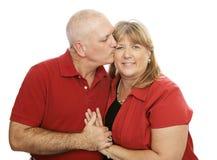 Liebende Küsse Stockfoto