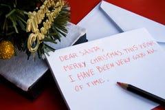 Lieber Sankt-Brief geschrieben von einem Kind für Weihnachten Lizenzfreies Stockbild