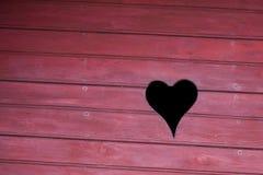 Liebes-Form auf einer Stall-Wand Lizenzfreie Stockfotografie