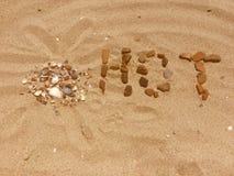 LIEBES- und HERZ-Zahlen auf einem Sand Lizenzfreie Stockfotografie