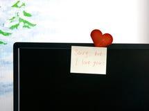 Liebesanmerkungen und -karte auf Schirm Lizenzfreie Stockbilder