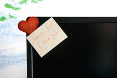 Liebesanmerkungen und -karte auf Schirm Stockfotos