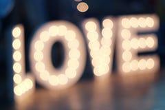 Liebesaufschrift vom Licht Stockbild