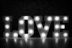 Liebesaufschrift vom Licht Stockfotografie