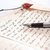 Liebesbrief mit einer Rose Stockfotografie