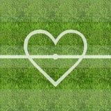Liebesfußball-Grasfeldhintergrund Stockfoto