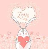 Liebeshäschen mit rotem Herzen Eine Vektorillustration Kaninchen in der Liebe stock abbildung