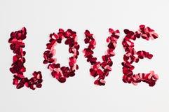 Liebeswort gemacht von den kleinen Herzen Lizenzfreie Stockfotografie