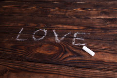Liebeswort geschrieben mit Kreide Lizenzfreie Stockfotos