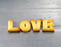 Liebeswort, Keksplätzchenbuchstaben Lizenzfreie Stockbilder