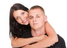 Liebevolles schönes junges glückliches Paar lokalisiert lizenzfreies stockfoto