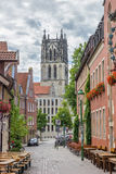 Liebfrauenkirsche church and cobblestoned street in Munster Stock Images