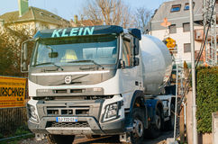 Liebherr cement mixer and Volvo FMX truck working unloading ceme Royalty Free Stock Photos
