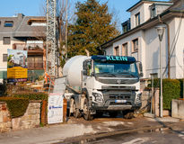 Liebherr cement mixer and Volvo FMX truck working unloading ceme Stock Photography
