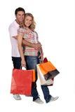 Liebkosung mit dem Einkaufen lizenzfreie stockfotos