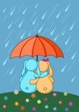 Liebres enamoradas bajo el paraguas Foto de archivo