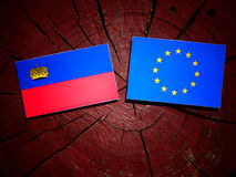 Liechtenstein flag with EU flag on a tree stump isolated Royalty Free Stock Images