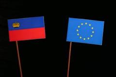Liechtenstein flag with European Union EU flag isolated on black. Background Stock Photos