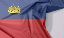 Liechtenstein tkaniny flaga zagniecenie z biel przestrzenią i krepa obraz royalty free