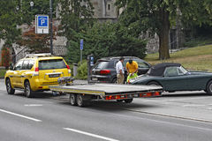 Liechtenstein - Vaduz - towing service. VADUZ, LIECHTENSTEIN - JULY 17: Service worker towing service helps with filling out the document for towing in Vaduz Royalty Free Stock Photo