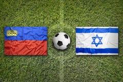 Liechtenstein vs. Israel flags on soccer field Stock Photo