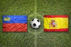 Liechtenstein vs. Spain flags on soccer field Stock Photos